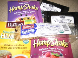 Yesterday's stash - Nutiva hemp seed, hemp shake mix, hem protein powder, and a flax-raisin bar (featured here half-eaten.  For the record, it was not sent in that condition - it was complete before I tore into it).